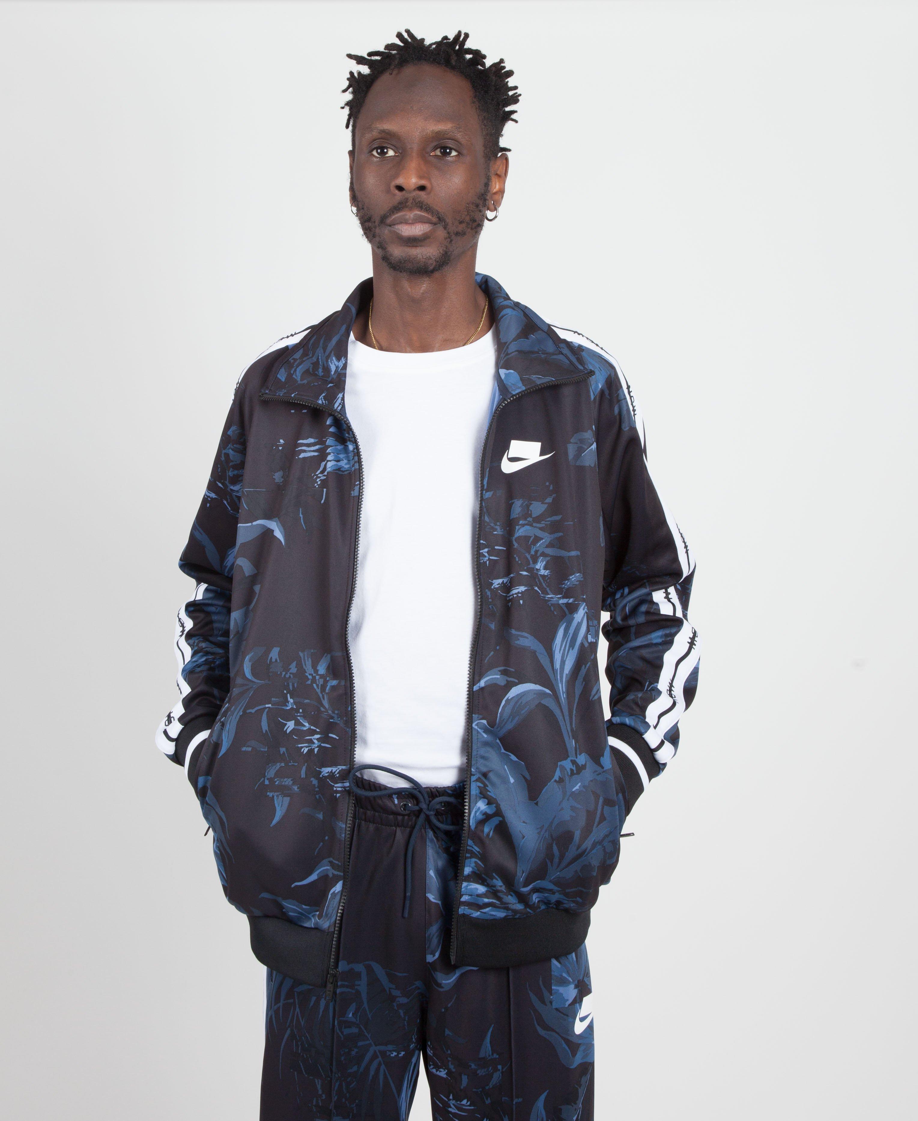 defd135930f0 Nike - Blue Black dark Obsidian white Floral Nsw Tape Track Jacket for Men.  View fullscreen