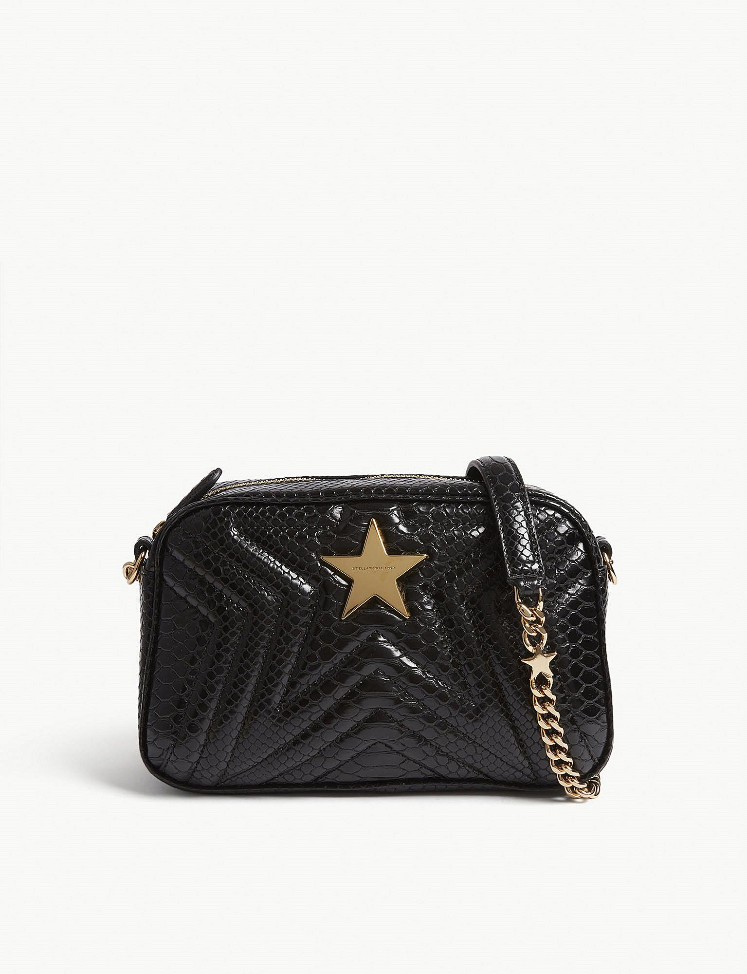 a1a0eca7f446 Lyst - Stella McCartney Quilted Python-embossed Star Camera Bag in Black