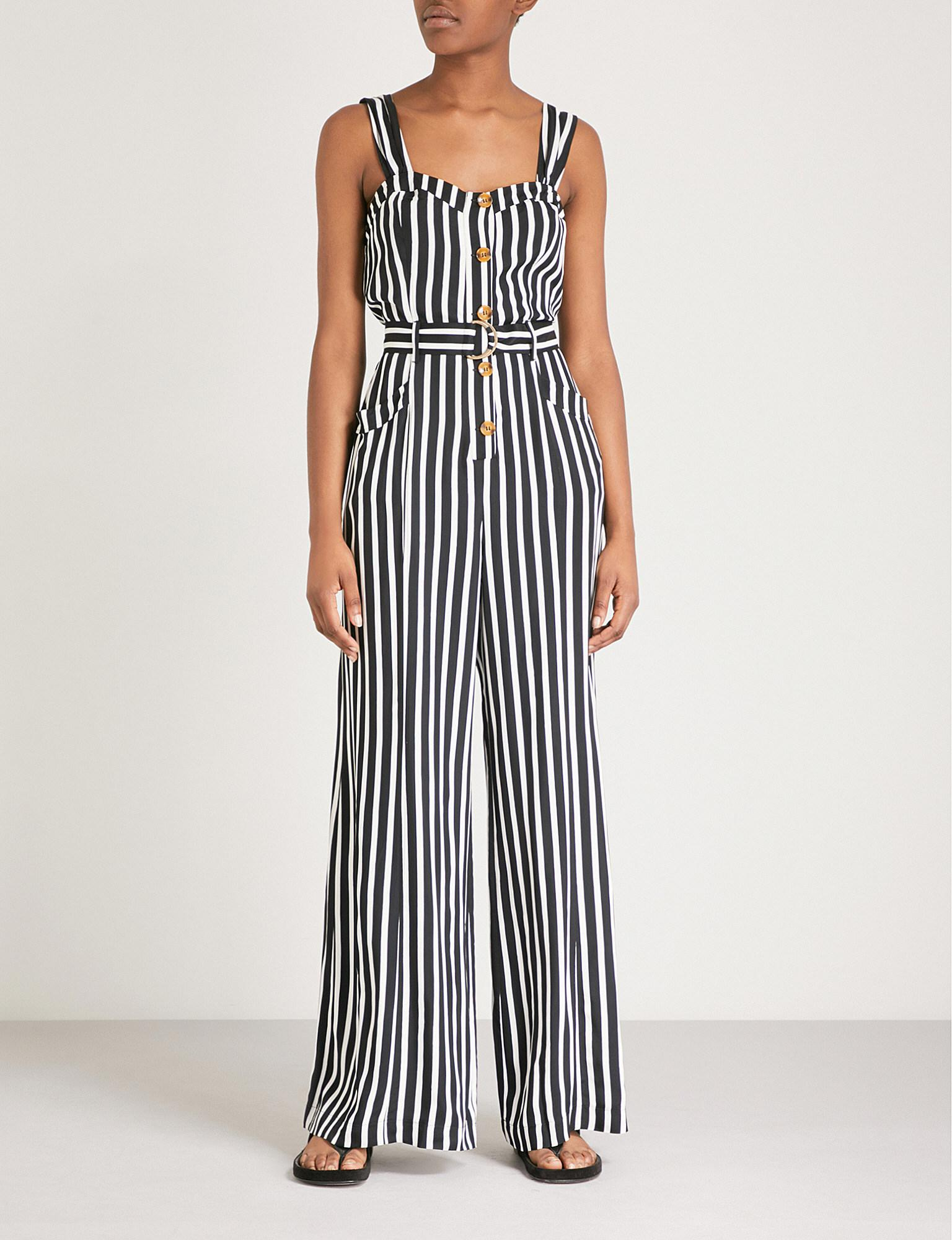418c69308ff6 Lyst - Free People City Girl Striped Satin Jumpsuit in Black