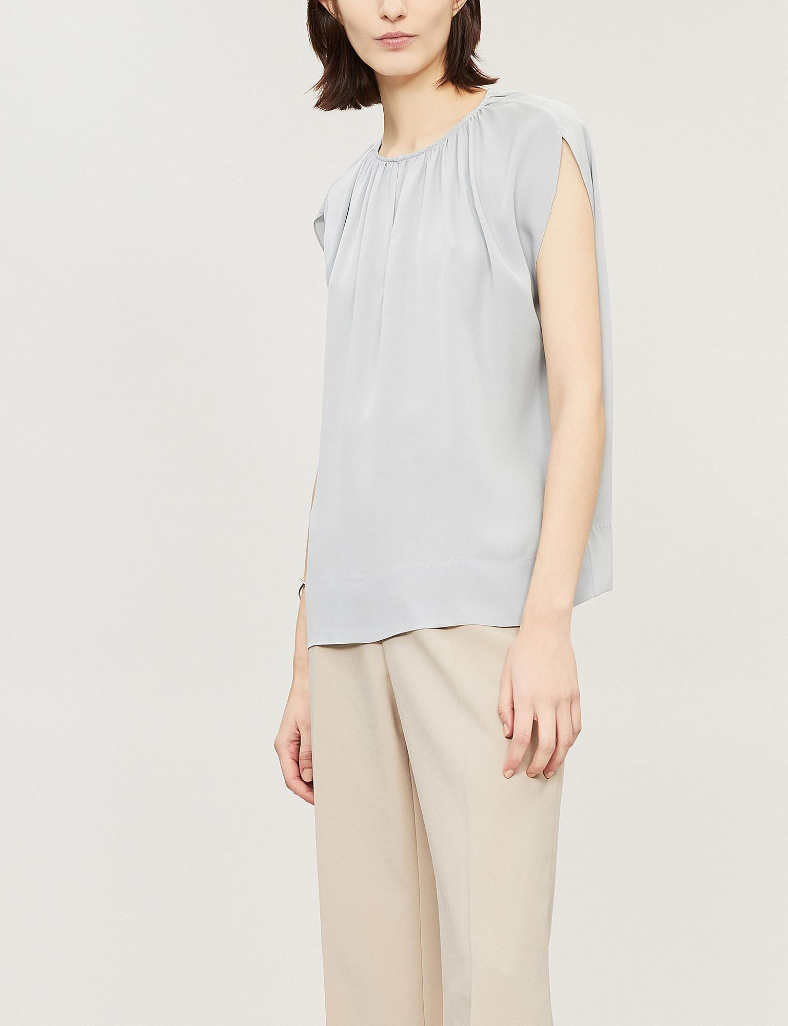 380e0f11693ce Lyst - Theory Cutout Gathered Silk Top in Blue