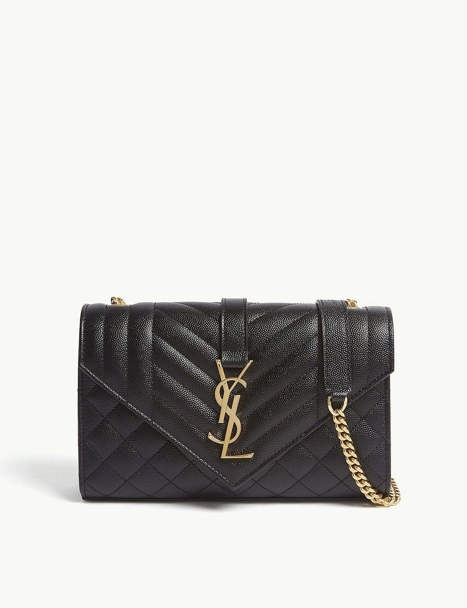 a0be832de855 Saint Laurent. Women s Black And Gold Monogram Quilted Pebbled Leather  Satchel