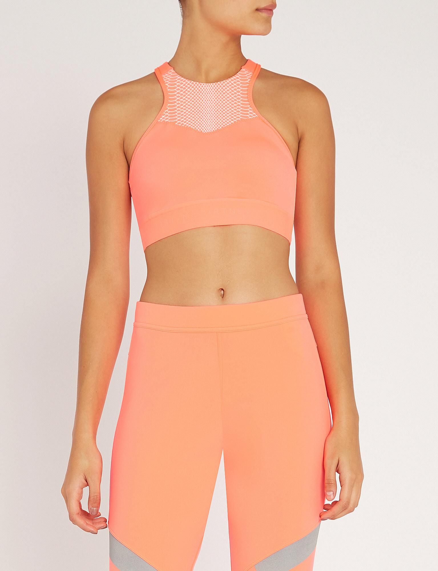 7babd6f621f29 adidas By Stella McCartney. Women s Orange Hiit Medium Support Stretch-jersey  Sports Bra