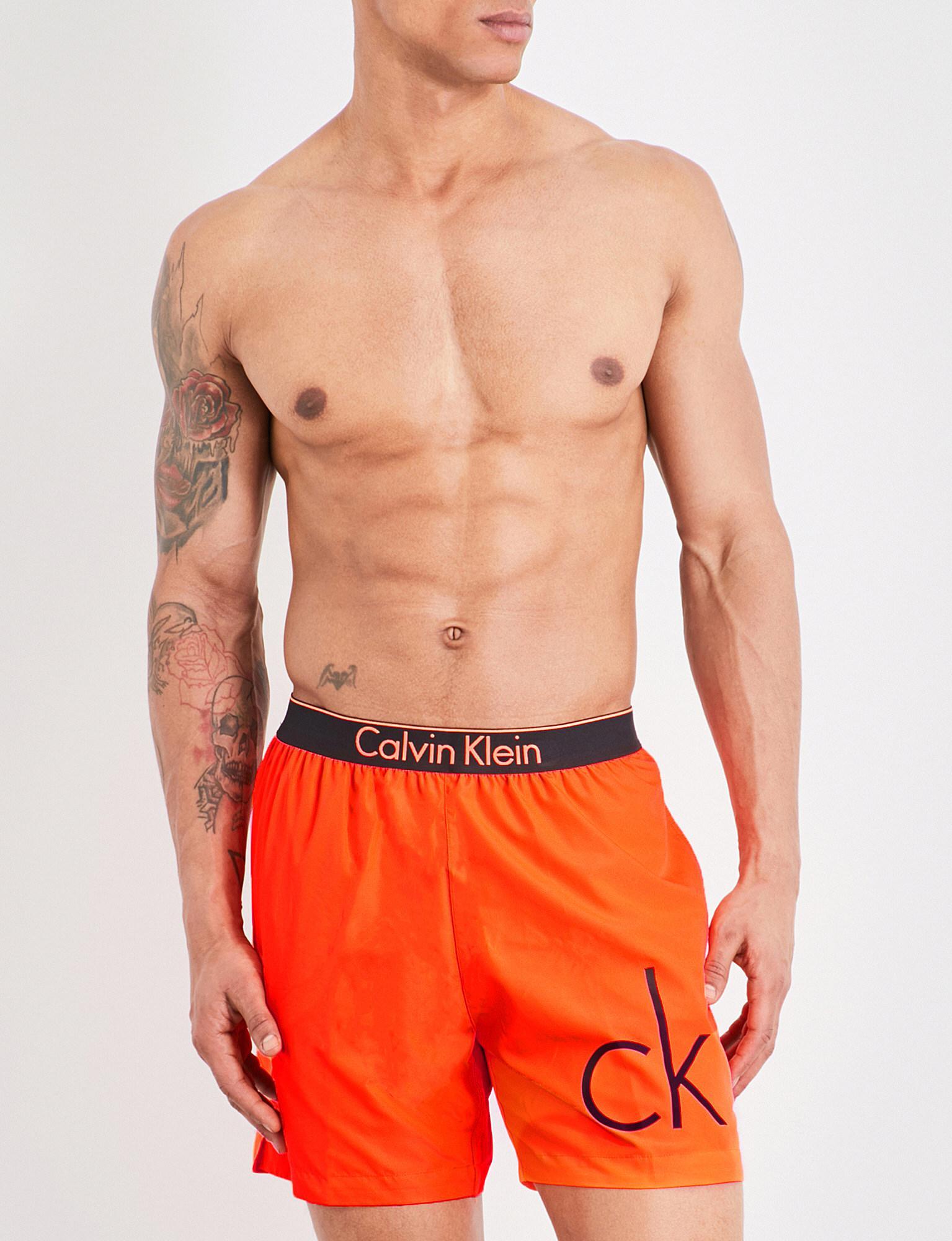 a7e029d1668 Lyst - Calvin Klein Neon Placed Logo Swim Shorts in Orange for Men