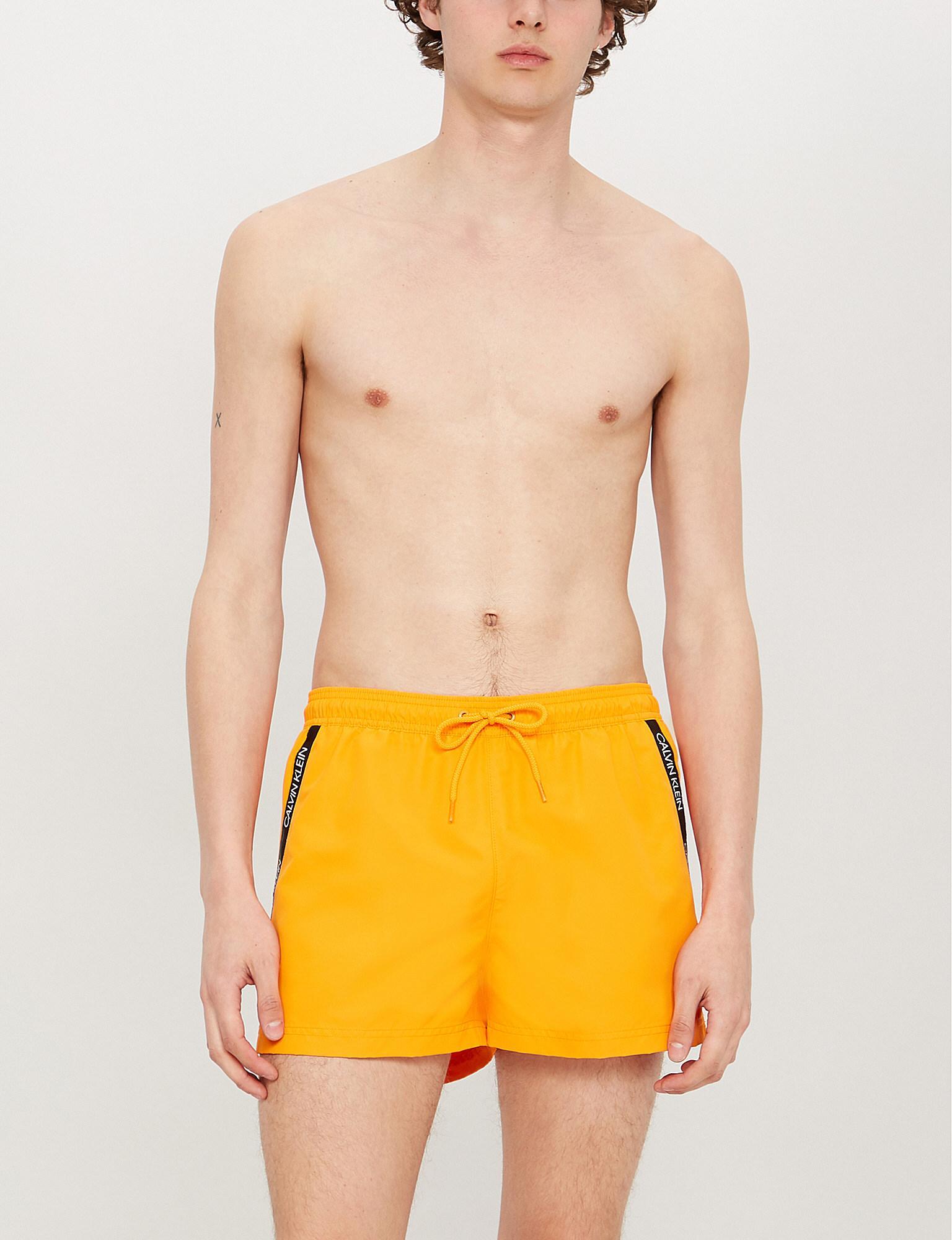 58154998e2 Calvin Klein - Orange Logo-print Swim Shorts for Men - Lyst. View fullscreen
