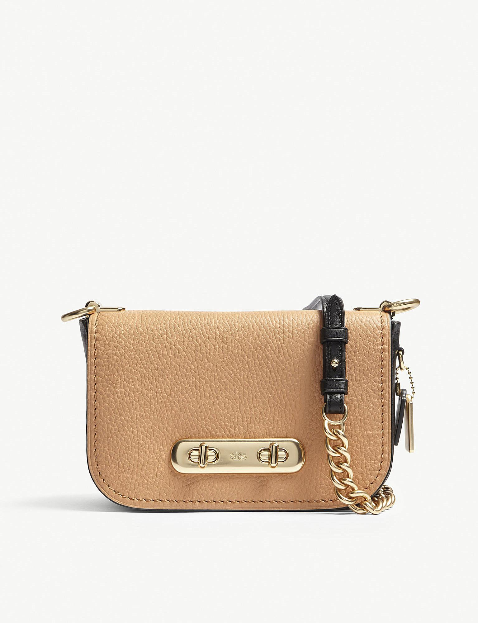 f857ddd7 COACH Swagger 20 Pebbled Leather Cross-body Bag in Brown - Lyst