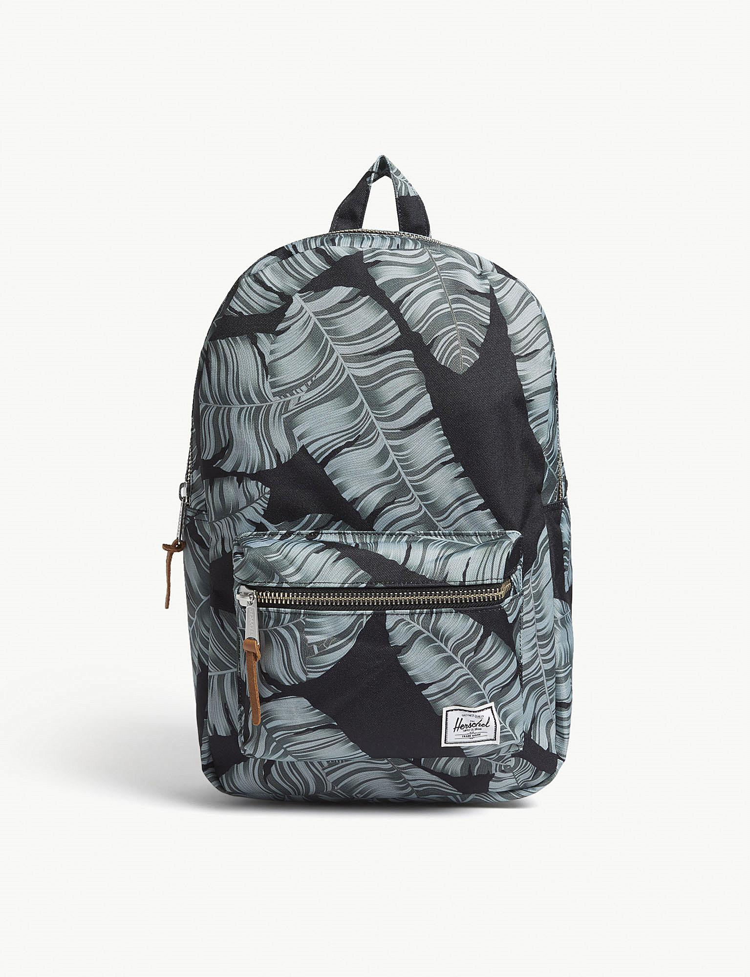Lyst - Herschel Supply Co. . Black Palm Floral Settlement Mid Volume ... 48e9e0b426565