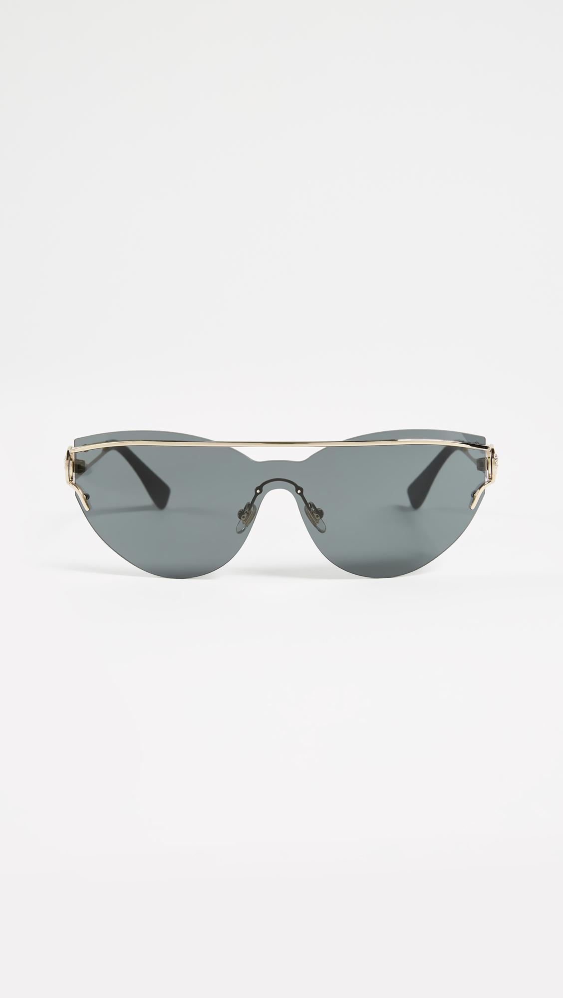 0cfdd0f35ead9 Versace Manifesto Sunglasses in Gray - Lyst