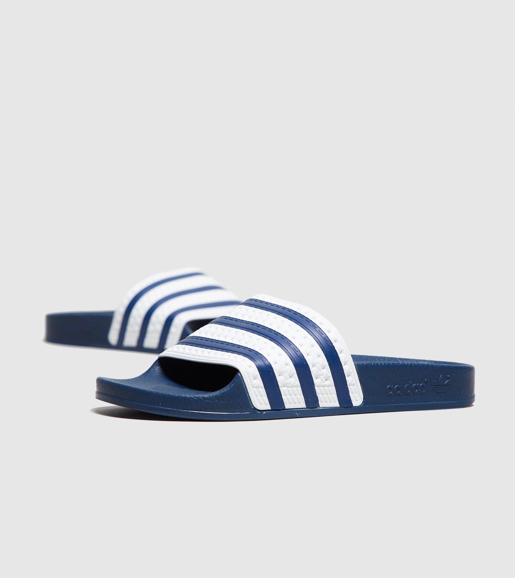 99bfce316f9e Lyst - adidas Originals Adilette Slides Women s in Blue for Men