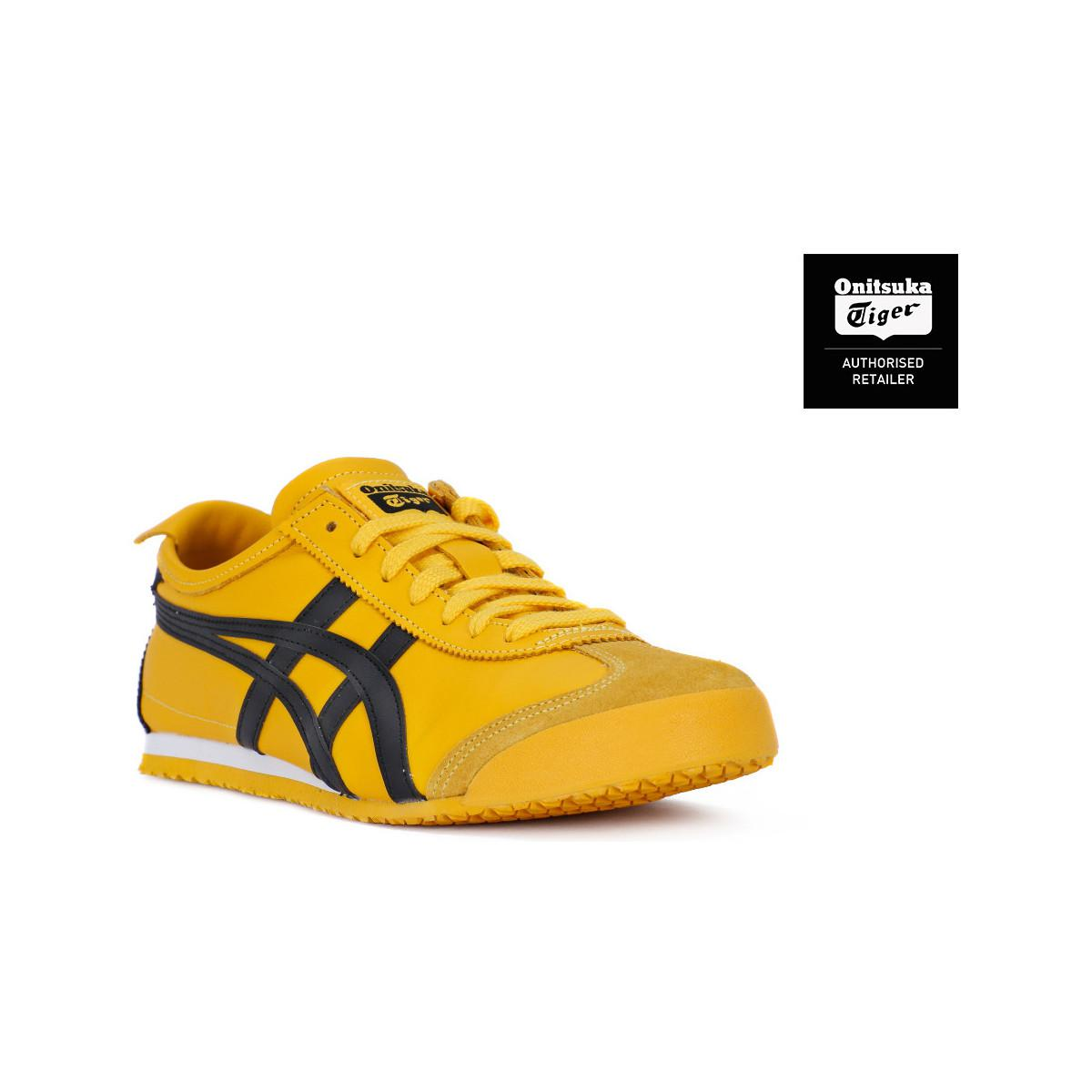 yellow asics trainers