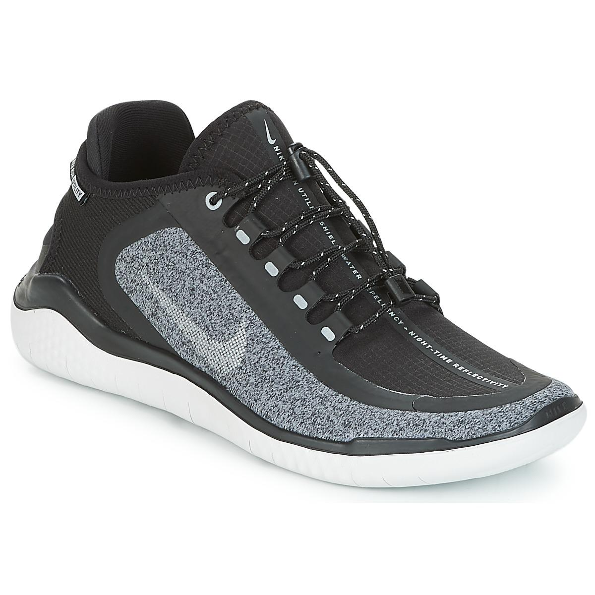 online store 85f4b d58a4 Tap to visit site. Nike - Free Run 2018 Shield Women's Running Trainers In  Black - Lyst