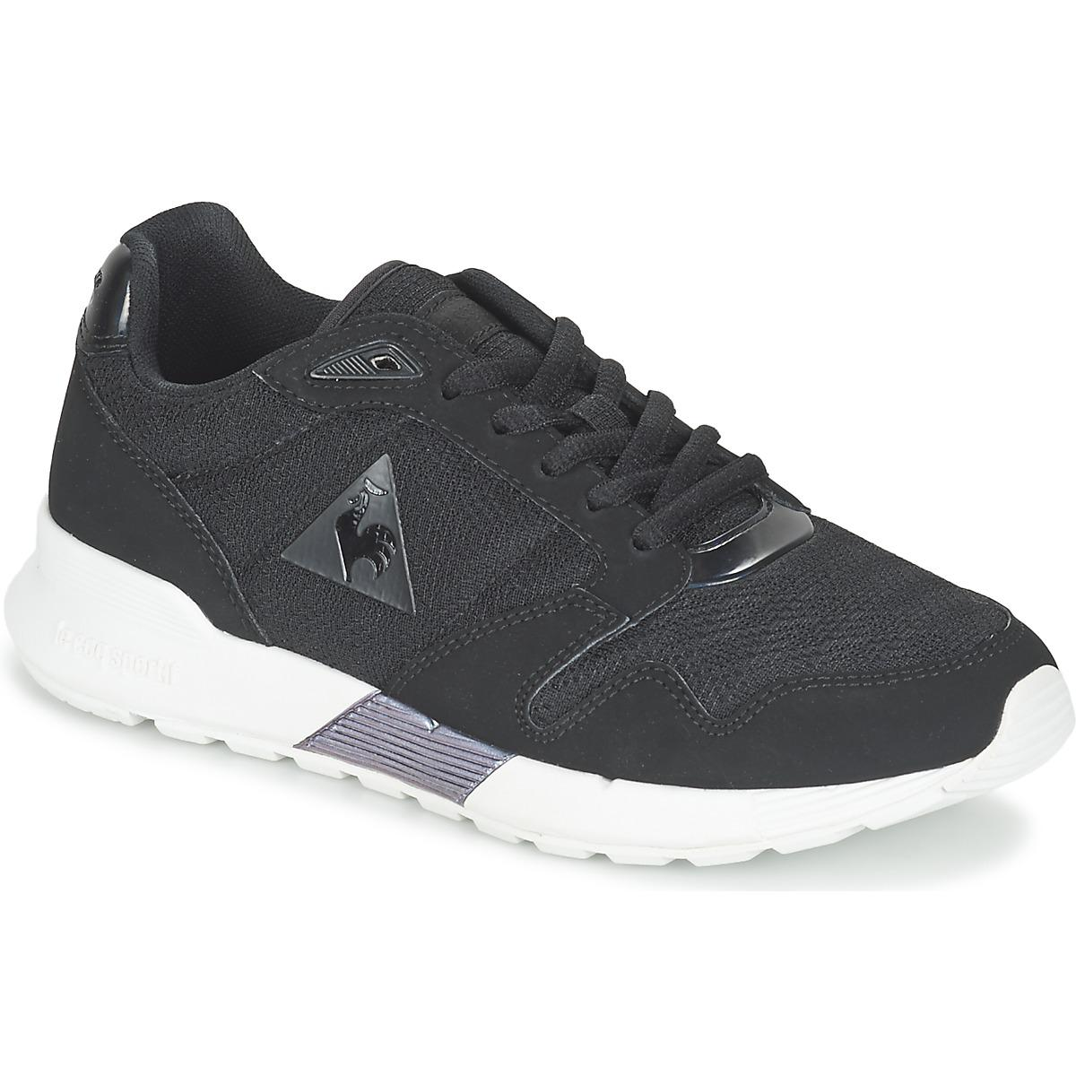 le coq sportif omega x w oil women 39 s shoes trainers in black in black lyst. Black Bedroom Furniture Sets. Home Design Ideas