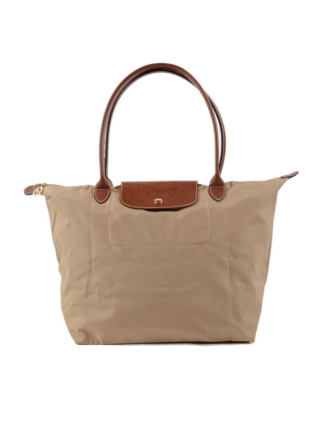 58f8f1d5ac79 Gallery. Previously sold at  Spinnaker · Women s Longchamp Le Pliage ...
