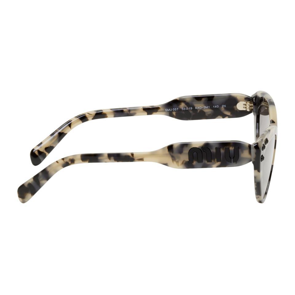 015a3688f13 Miu Miu - Natural Beige Logomania Cat-eye Sunglasses - Lyst. View fullscreen