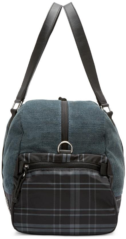 lyst diesel navy deyanki duffle bag in blue for men
