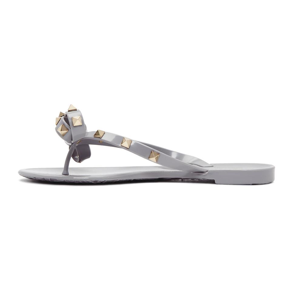 f66dc2070 Lyst - Valentino Grey Garavani Rockstud Jelly Bow Sandals in Gray