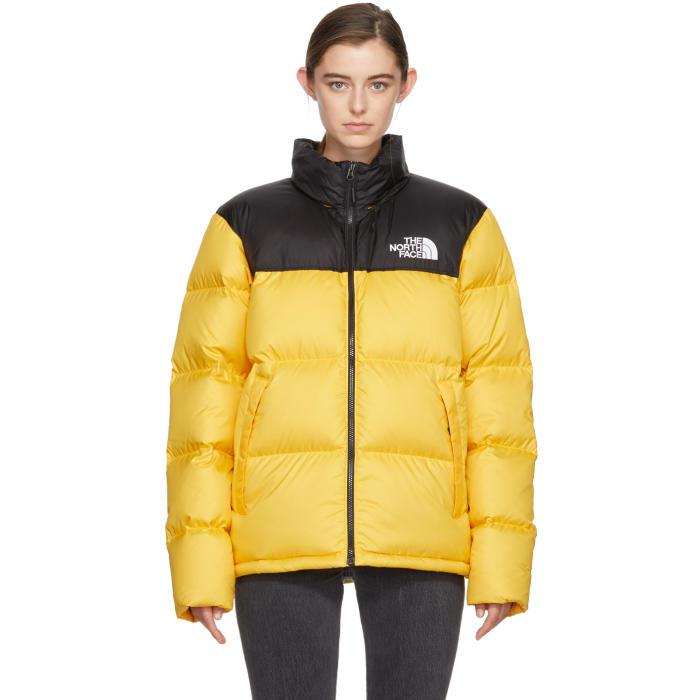 The North Face Yellow   Black Down Novelty Nuptse Jacket in Yellow ... 317281f322a1
