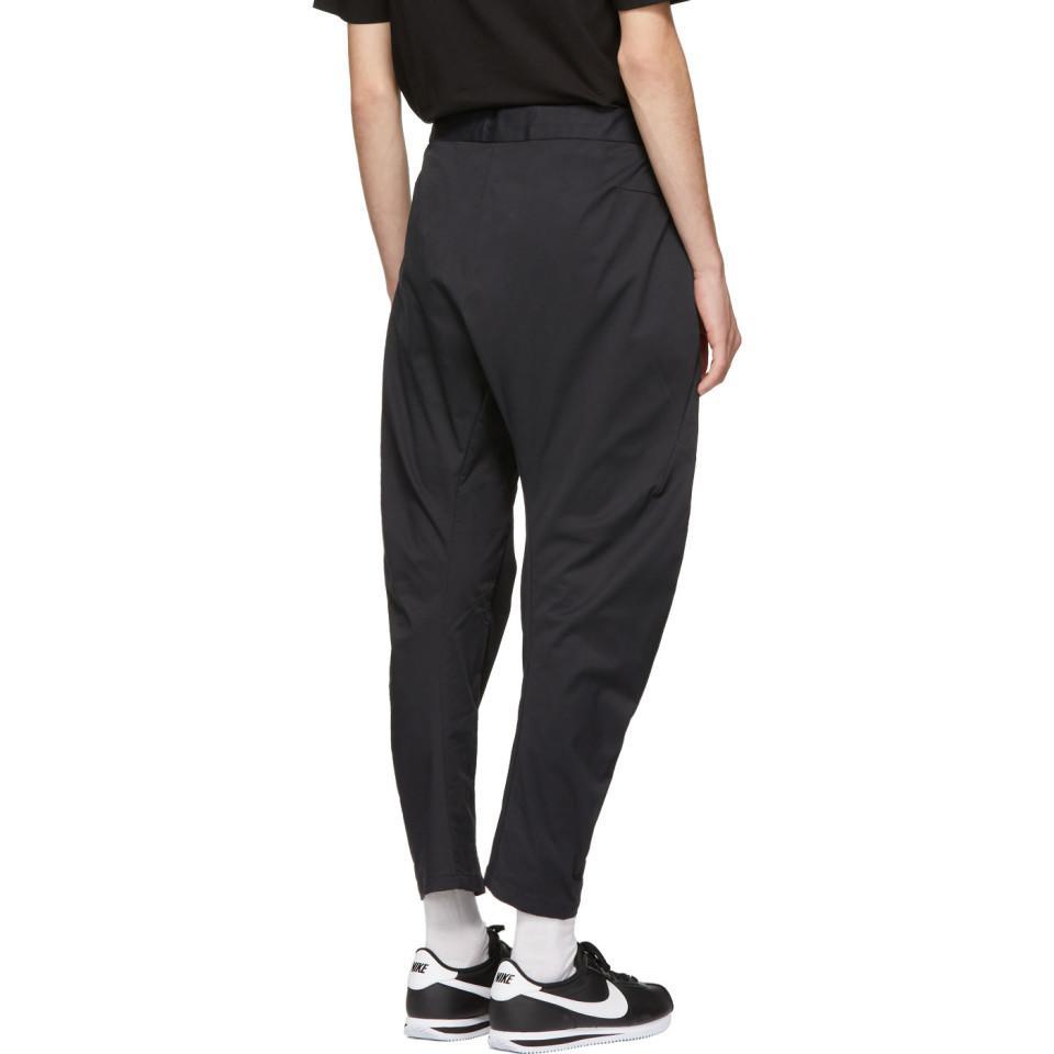 Nike - Black Pantalon cargo tisse noir Tech Pack for Men - Lyst. Afficher  en plein écran 7bd1651799f0