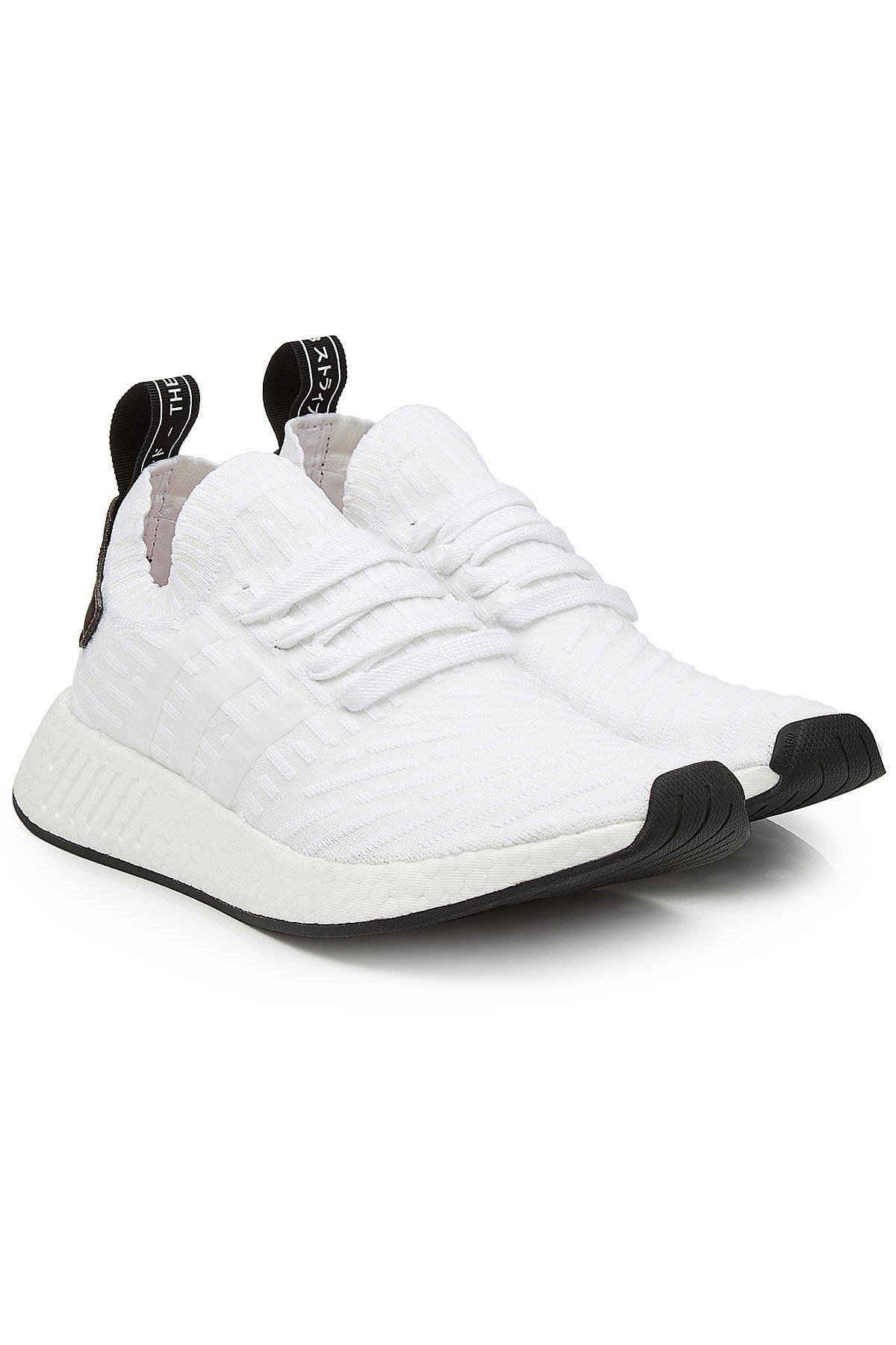lyst adidas originali nmd r2 primeknit scarpe bianche per gli uomini.