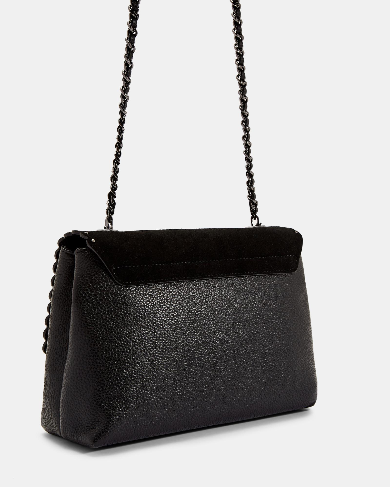 32b67f4de Lyst - Ted Baker Studded Circle Lock Leather And Suede Bag in Black