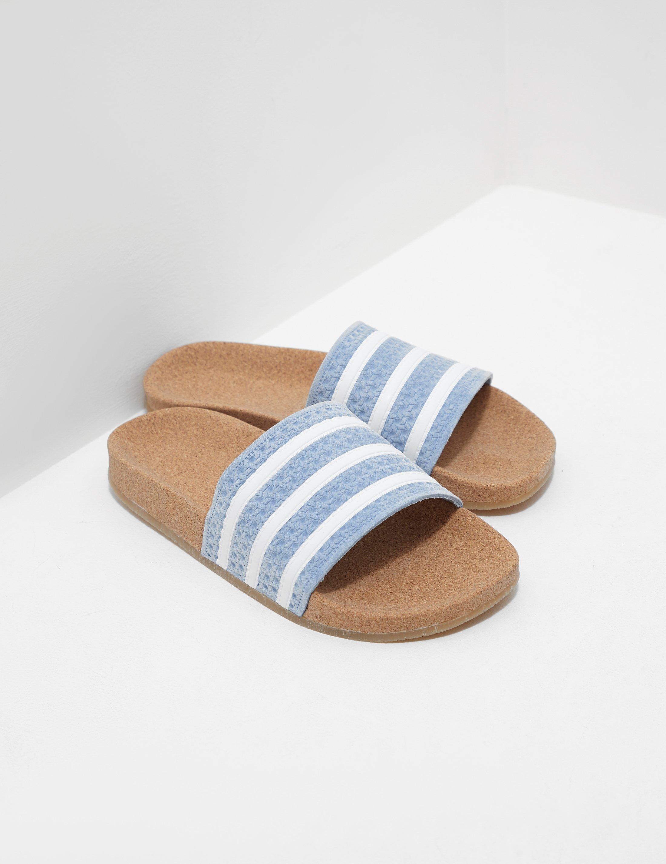 5828276a211b ... new zealand adidas originals. womens blue adilette suede slides 98da1  226eb