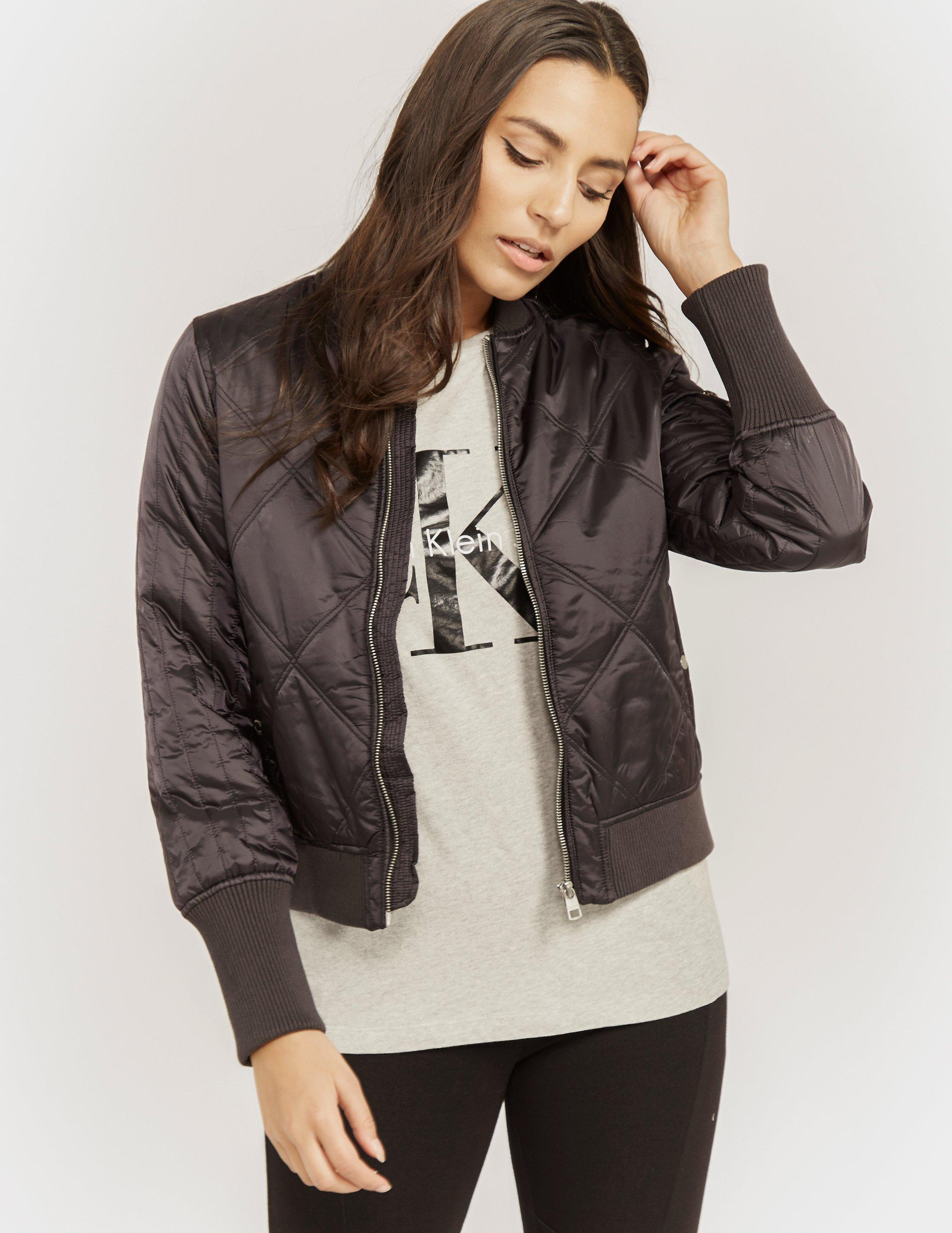 lyst calvin klein opal quilted bomber in black. Black Bedroom Furniture Sets. Home Design Ideas