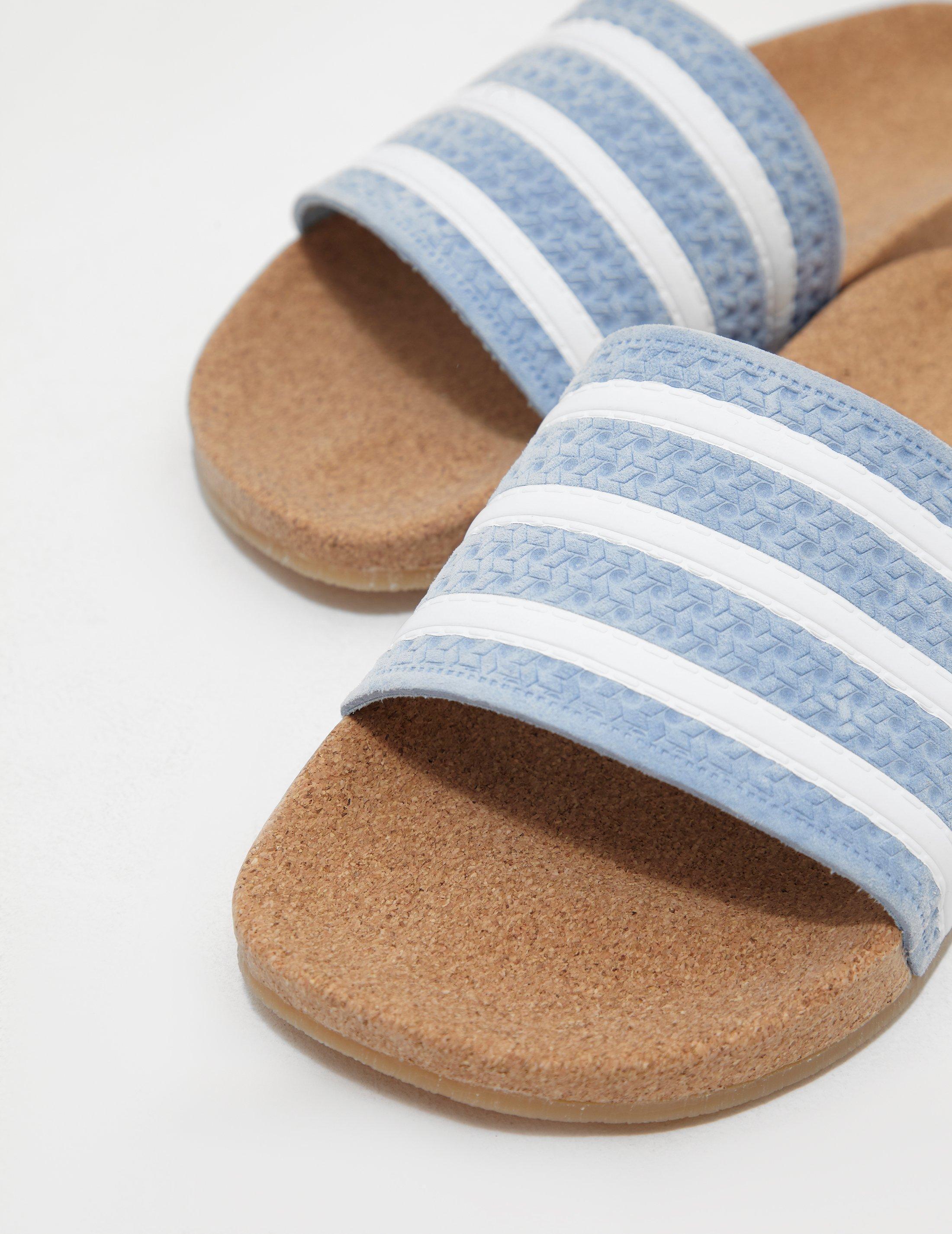 pretty nice 2dd00 e98e1 Lyst - adidas Originals Womens Adilette Cork Slides Blue in