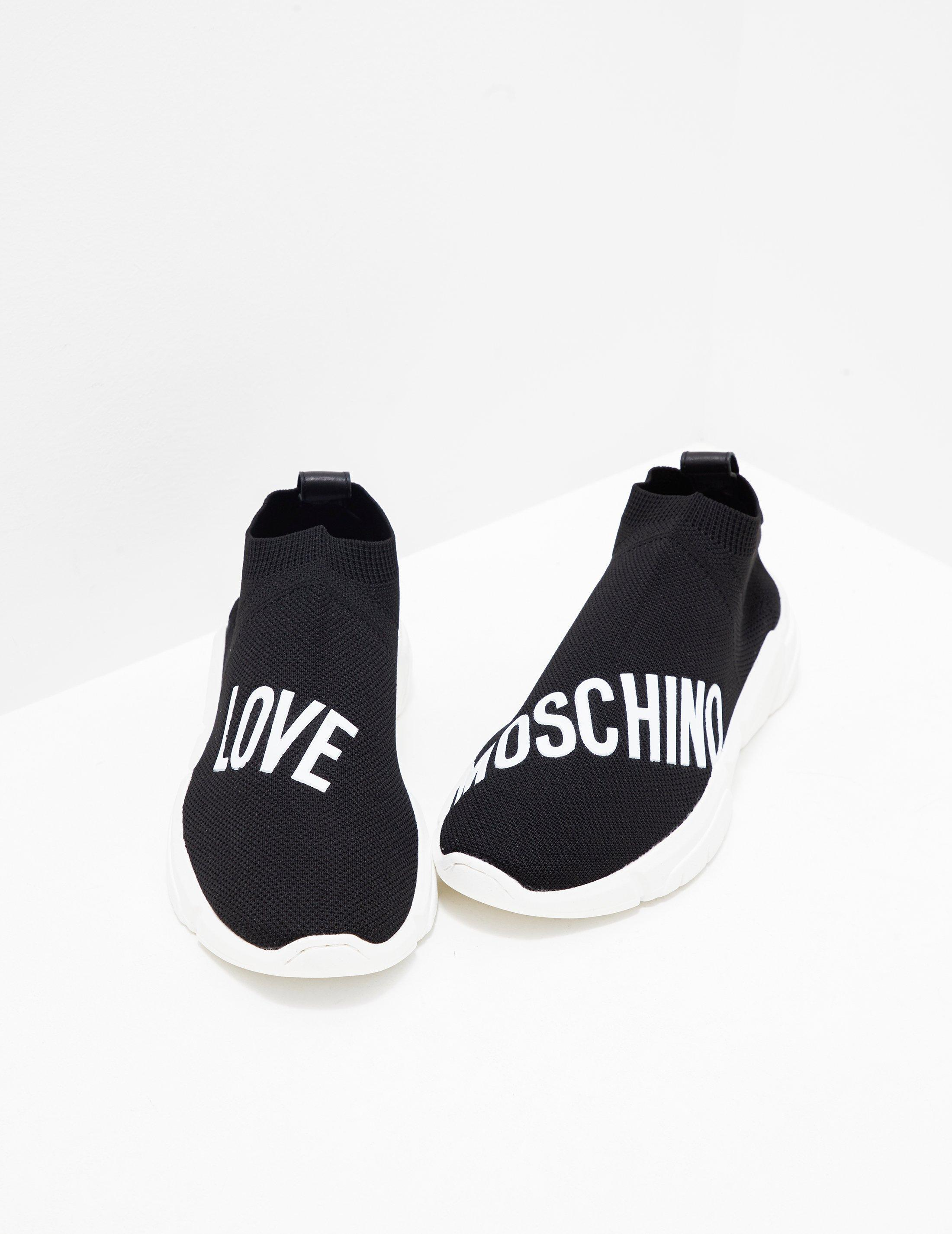 c391bf40c3 Love Moschino Womens Logo Sock Trainer Black in Black - Lyst
