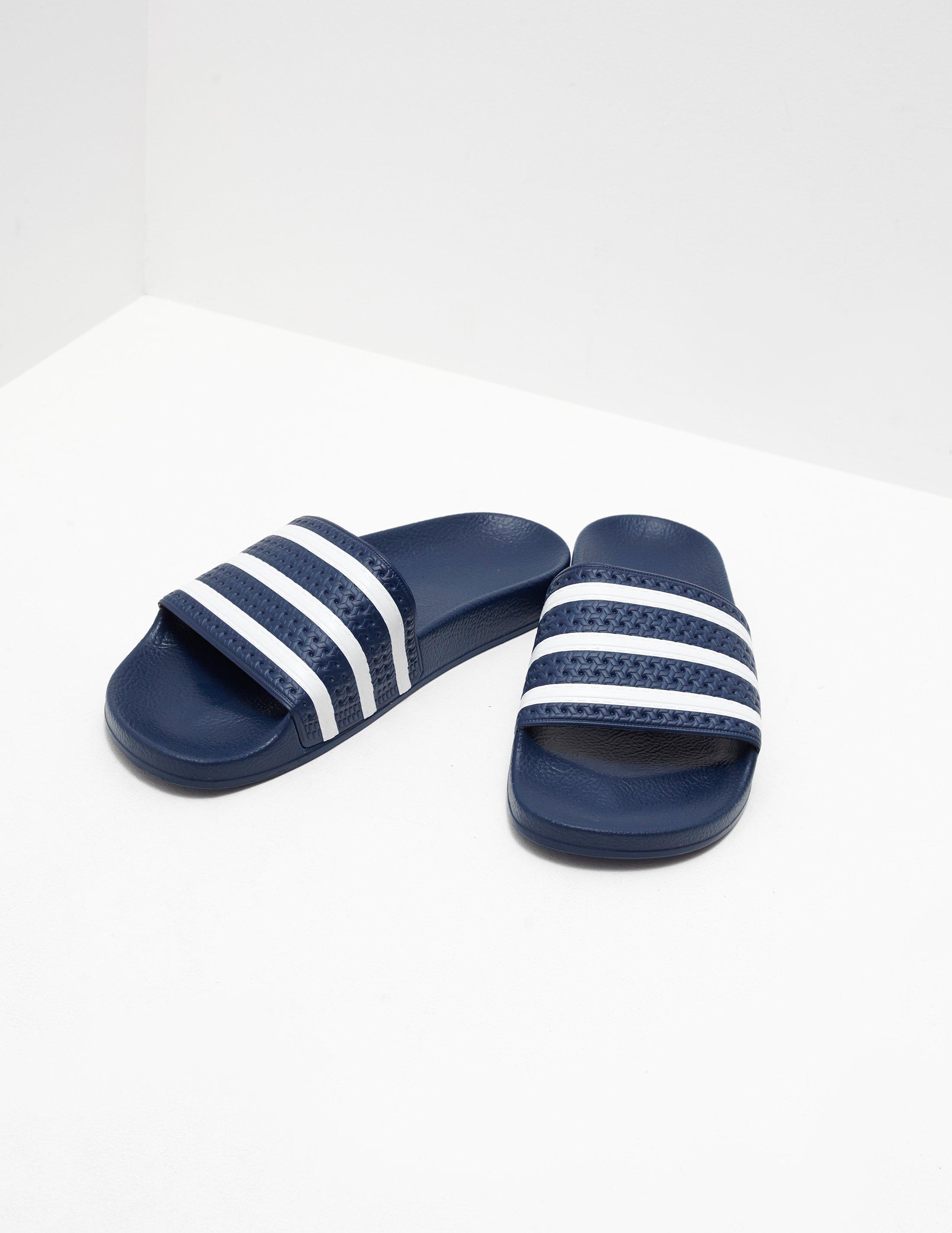 0bada49f95ebc adidas Originals Mens Adilette Slides Blue in Blue for Men - Lyst