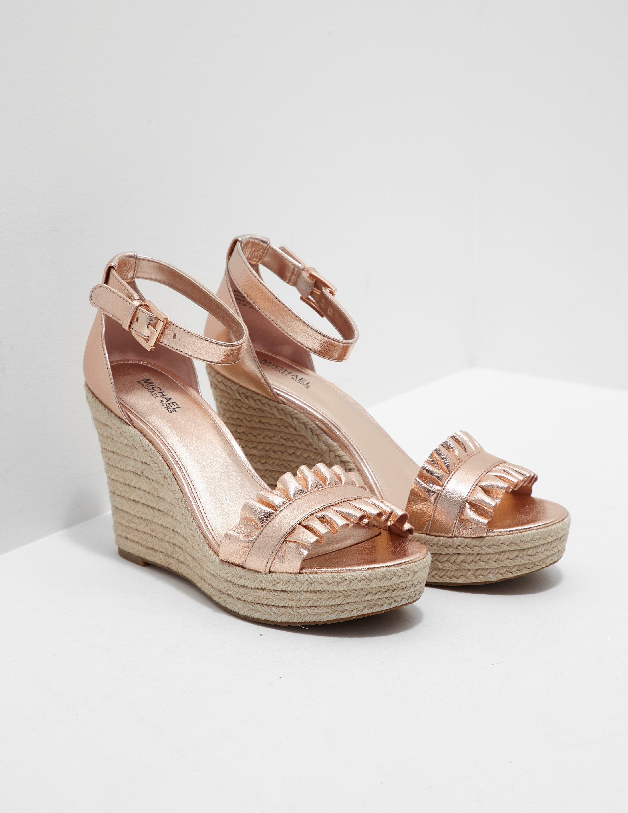 6724e5db2c4d Lyst - Michael Kors Bella Wedges Gold in Metallic - Save 17%