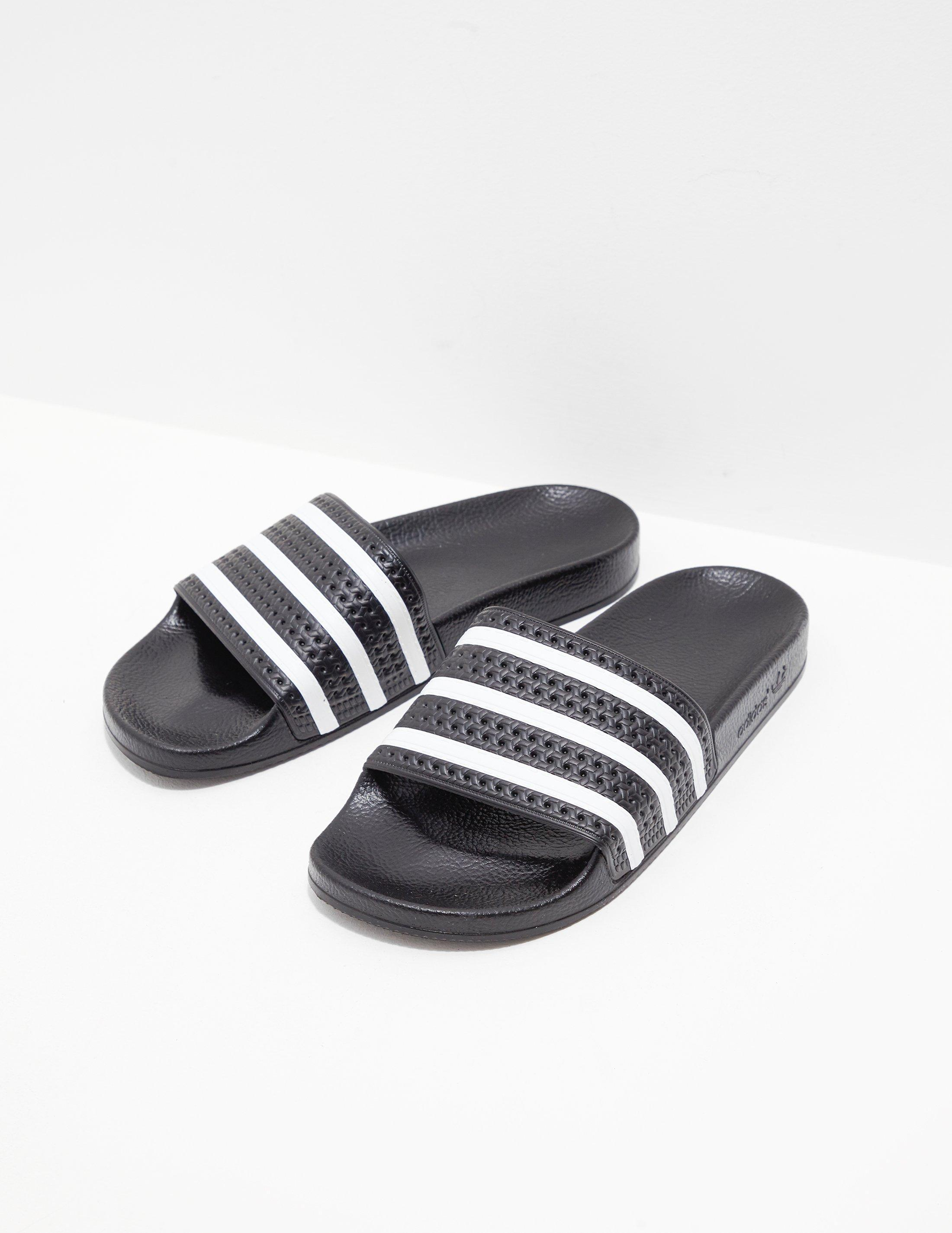 21eccc1a1e26 Lyst - adidas Originals Adilette Slides Black in Black for Men