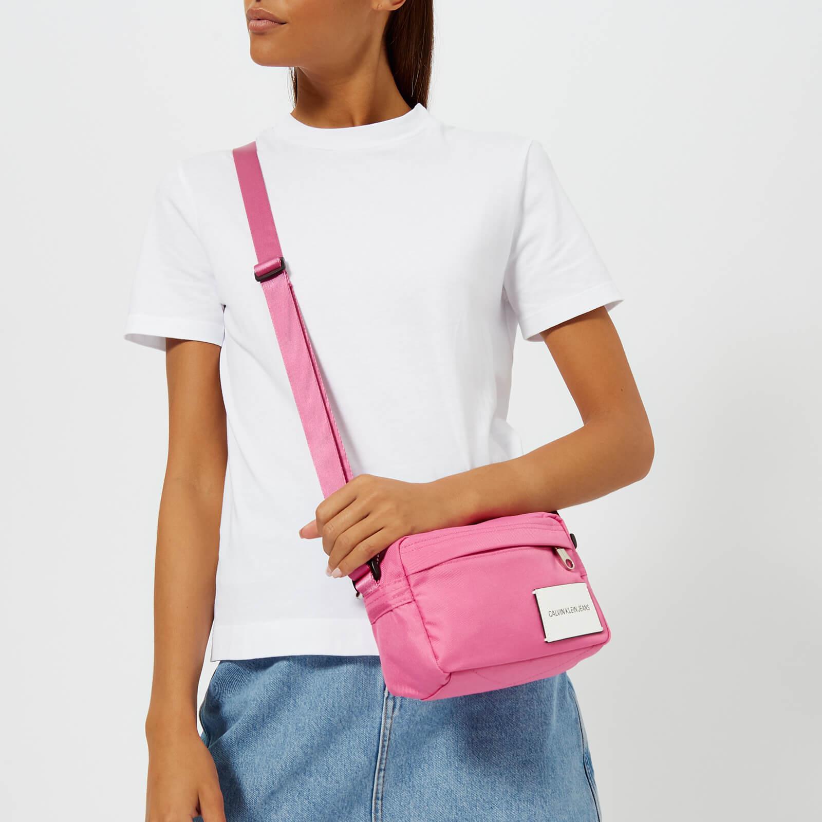 03796c296a Calvin Klein Sport Essential Camera Cross Body Bag in Pink - Lyst