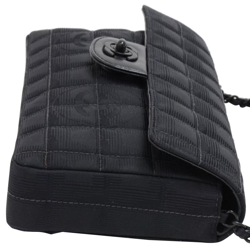 0fca3a504333 Chanel Quilted Nylon New Travel Line East-west Flap Bag in Black - Lyst