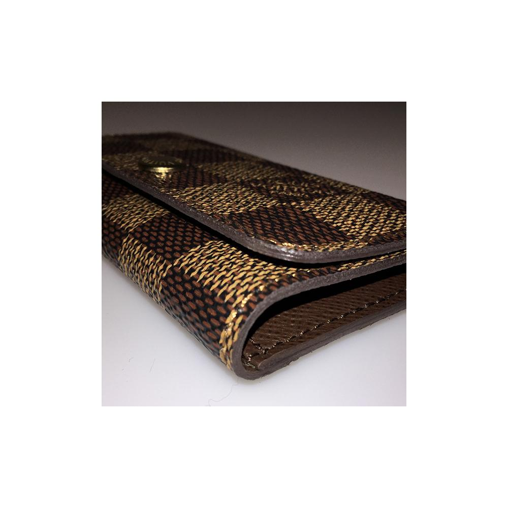 e8fed6010c4b Lyst - Louis Vuitton Damier Ebene Canvas 4 Key Holder in Brown