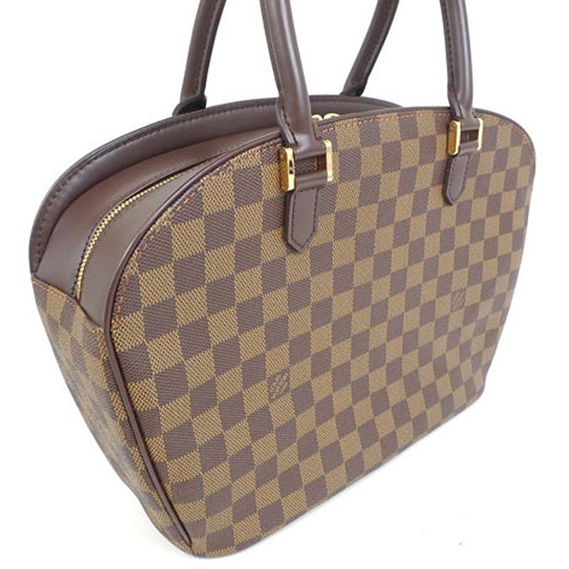 Lyst - Louis Vuitton Damier Ebene Canvas Sarria Horizontal Bag in Brown f3ce0c6209