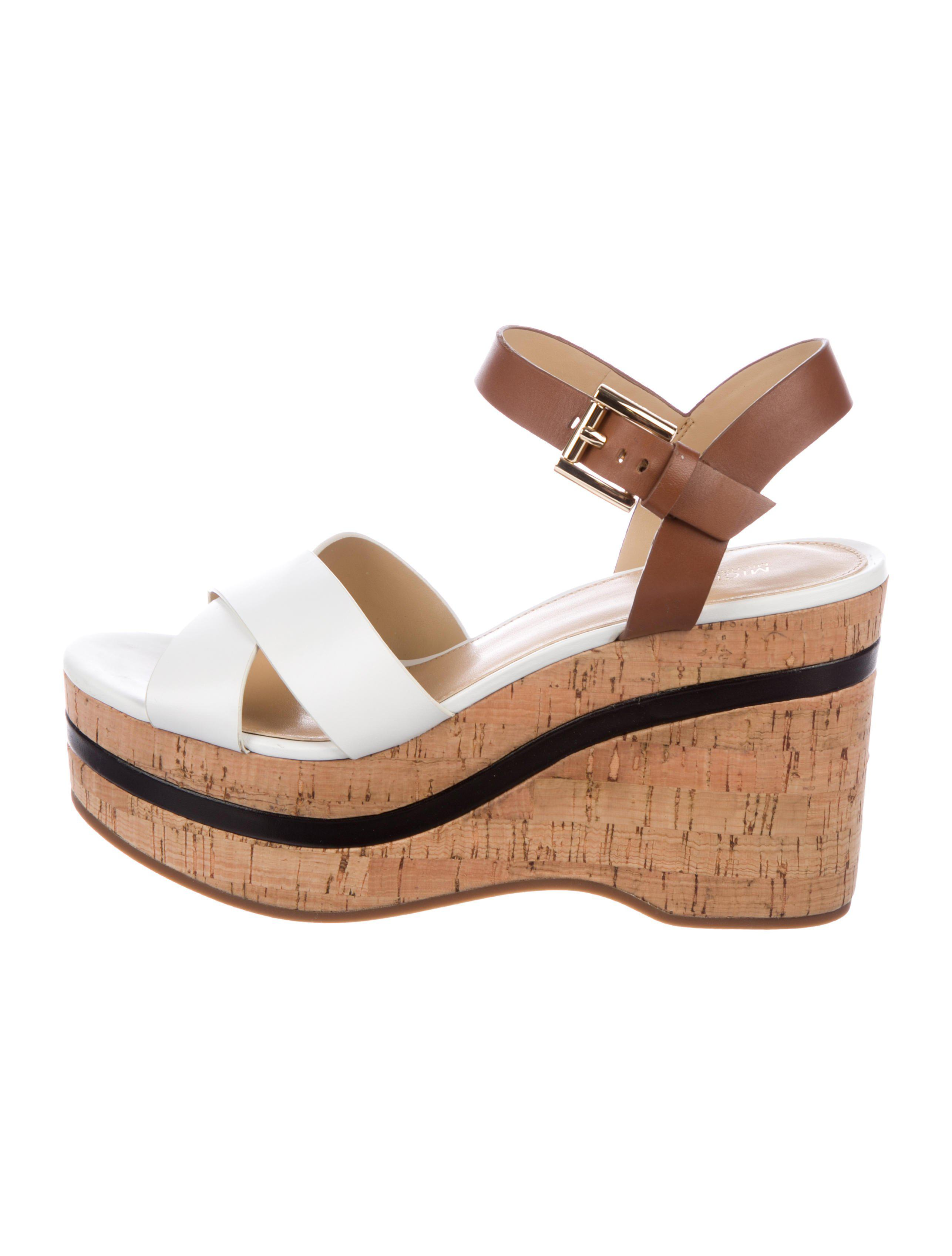cc7d2d30f15 MICHAEL Michael Kors. Women s Natural Michael Kors Crossover Wedge Sandals  White