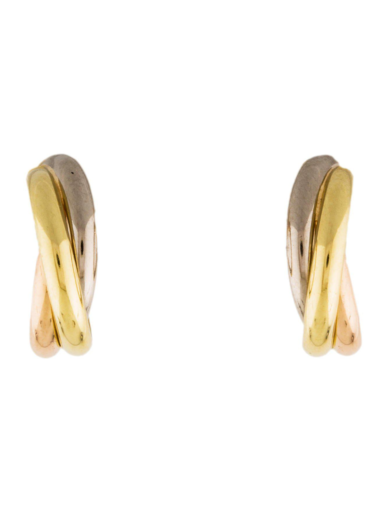 a white cartier trinity earrings yellow pink de gold