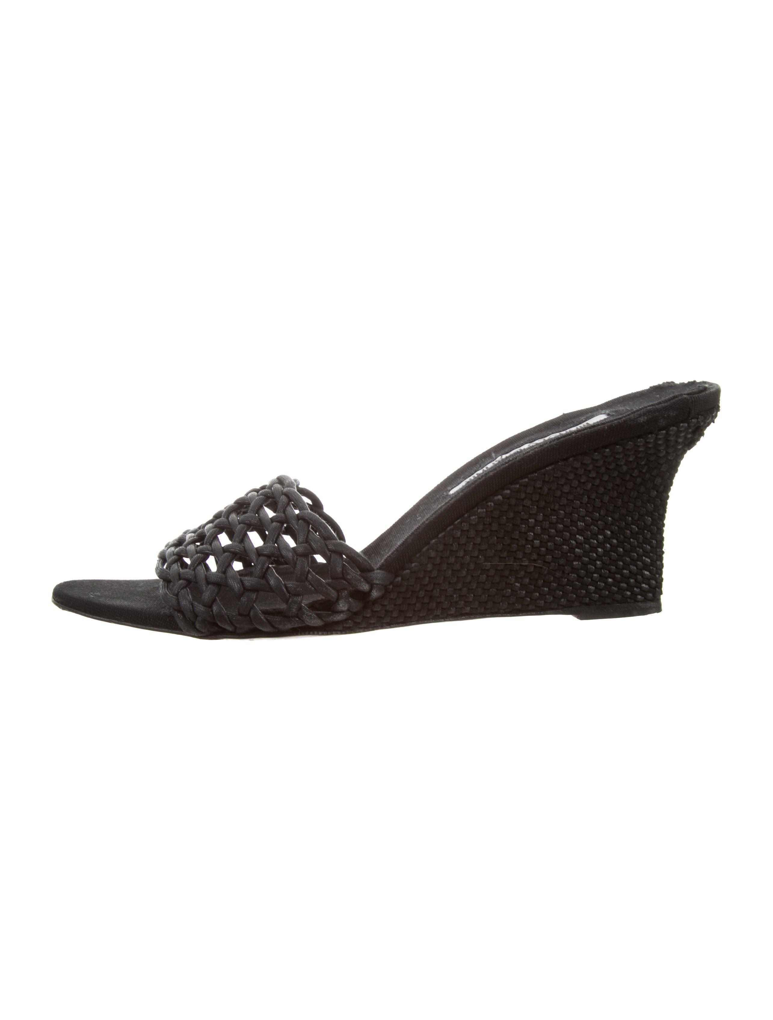 c2a26f87b609 Lyst - Manolo Blahnik Woven Coated Canvas Wedges in Black