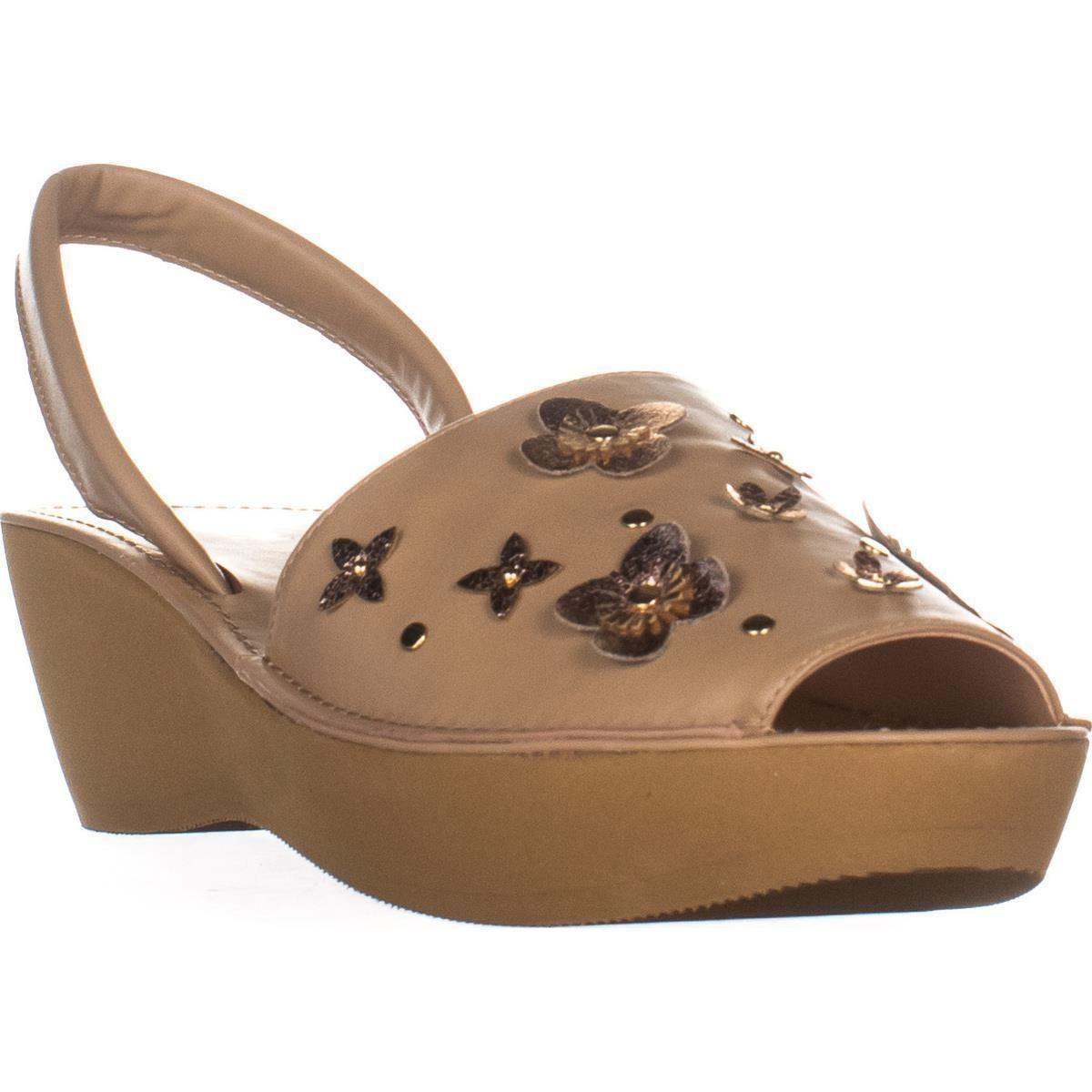 e1ef412fb8df Kenneth Cole. Women s Natural Reaction Fine Glass Perforated Wedge Sandals