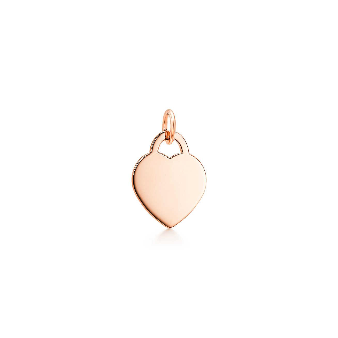 Tiffany Charms oval tag in 18k rose gold with a spessartite, mini Tiffany & Co.