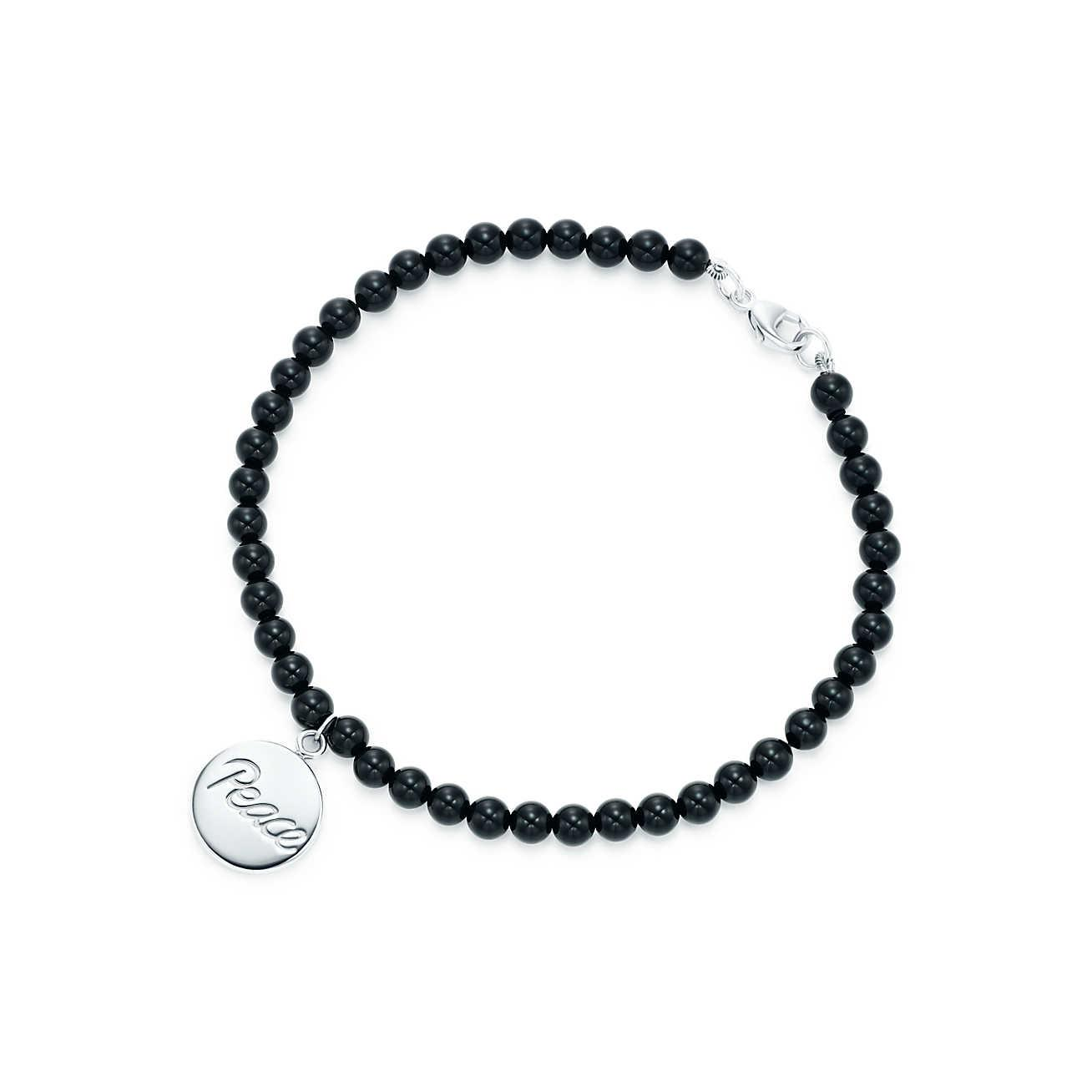 63862cde8 Tiffany & Co. Peace Tag In Sterling Silver On An Onyx Bead Bracelet ...