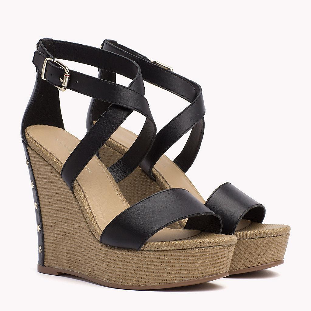 1c9f76b1b Tommy Hilfiger Studded Leather Wedge Sandals in Black - Lyst