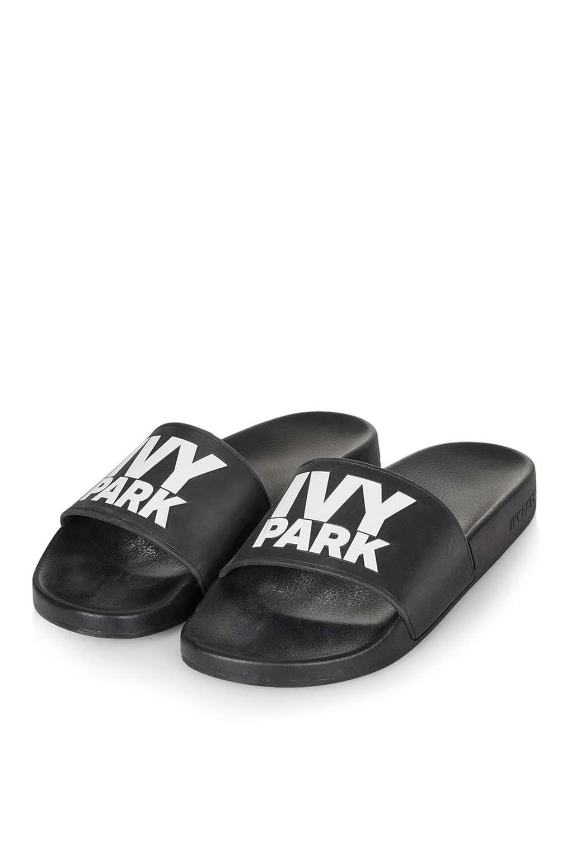 ed2855741672 Lyst - Ivy Park Logo Rubber Slides in Black