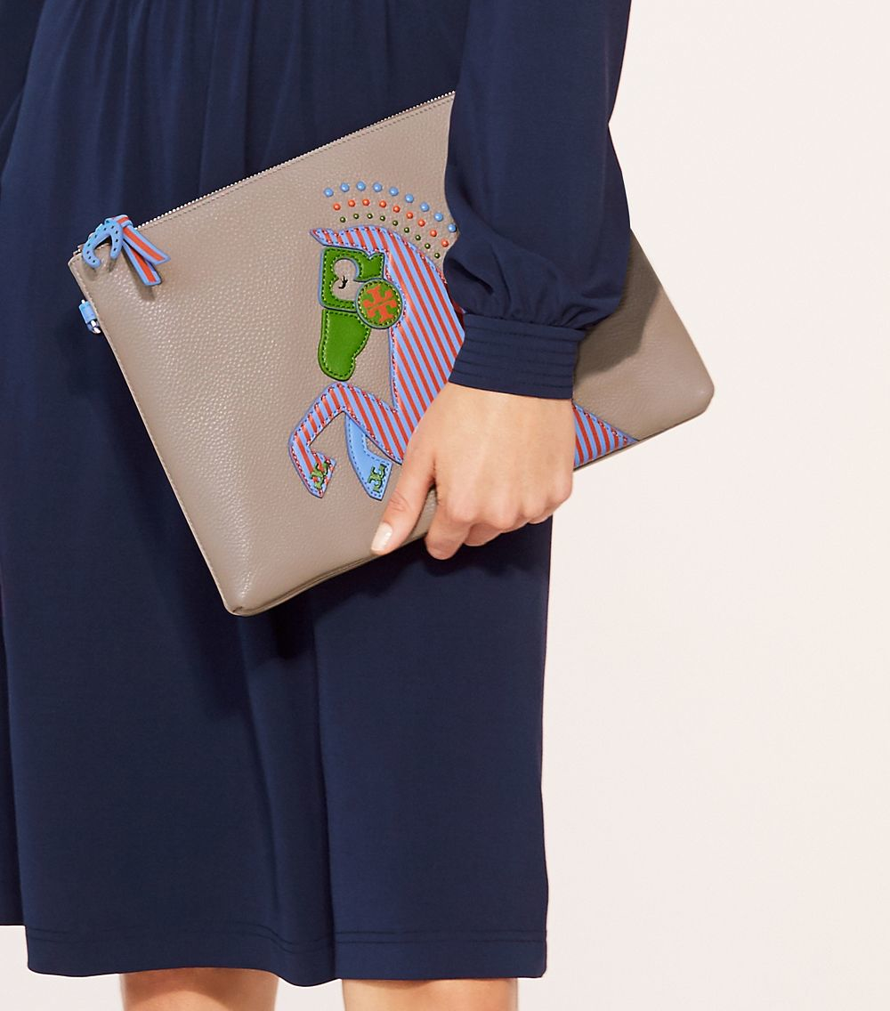 f30130daa316 Lyst - Tory Burch Horse Large Pouch in Blue