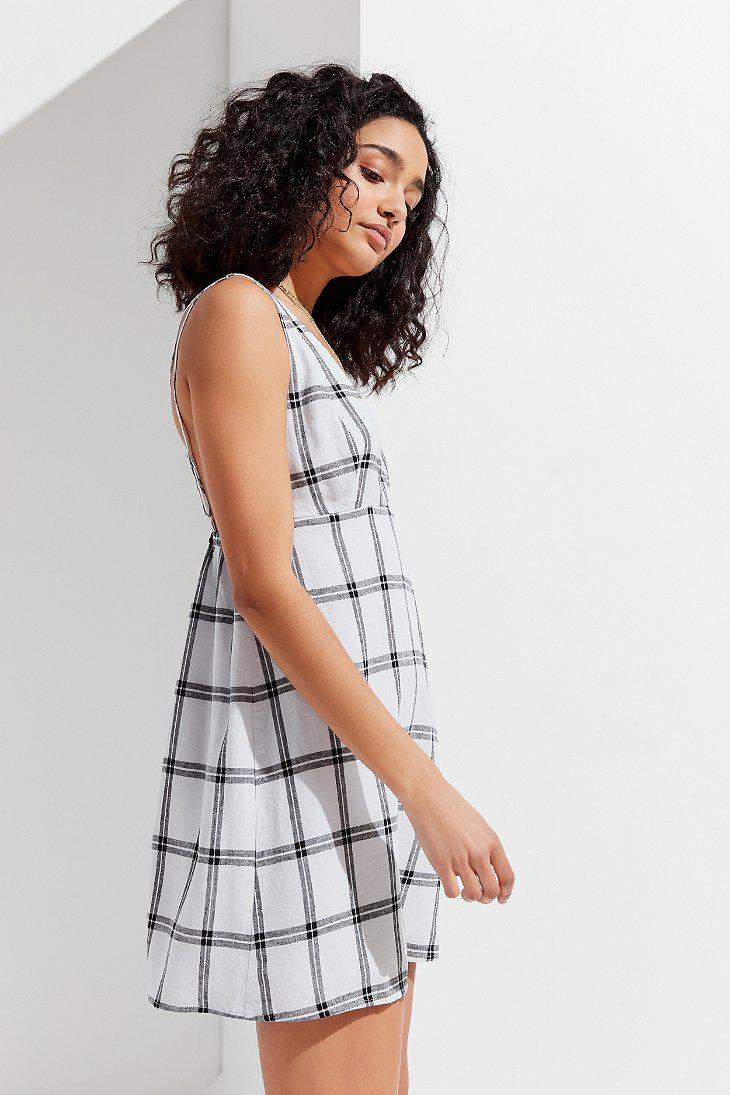 b78ac3281c Lyst - Urban Outfitters Uo Breezy Plunging Linen Mini Dress in Black