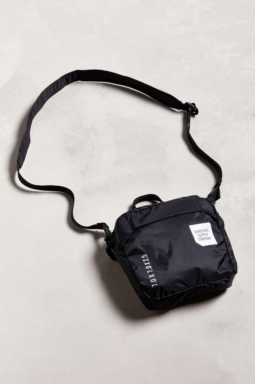 f759767c29c Herschel Supply Co. Men s Black Ultralight Sling Bag.  40  25 From Urban  Outfitters