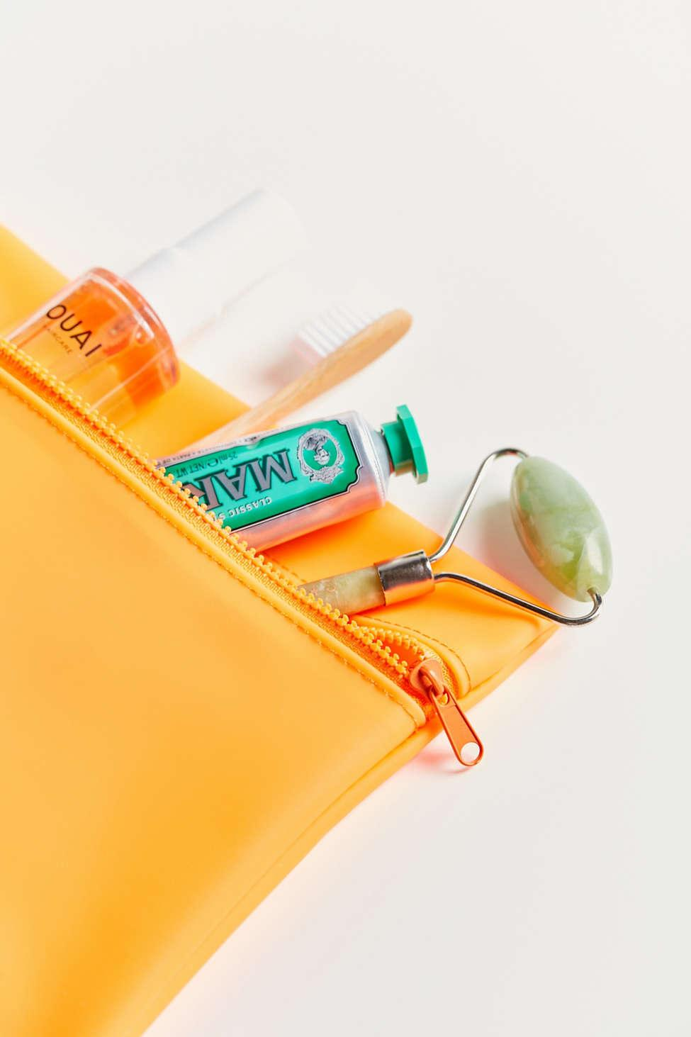 Lyst Urban Outfitters So Jelly Makeup Bag In Orange