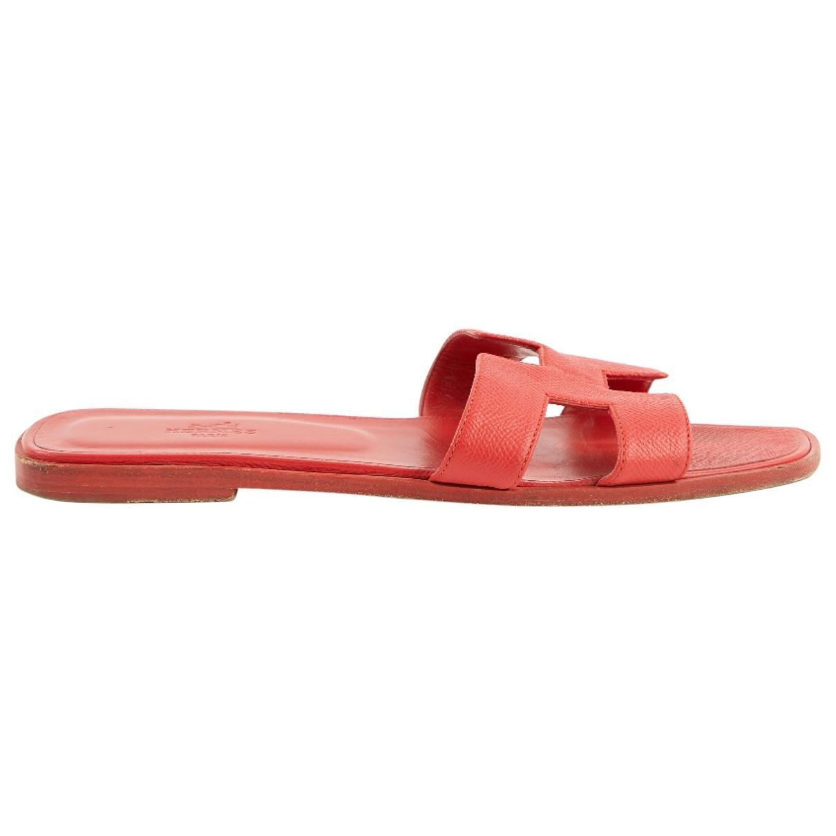 d2a3164c83a1 Hermès Oran Leather Sandals in Red - Lyst