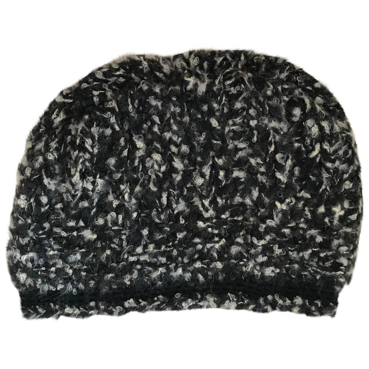 a2697ae8118e1 Chanel. Women s Pre-owned Black Cashmere Hats. £341 £316 From Vestiaire  Collective
