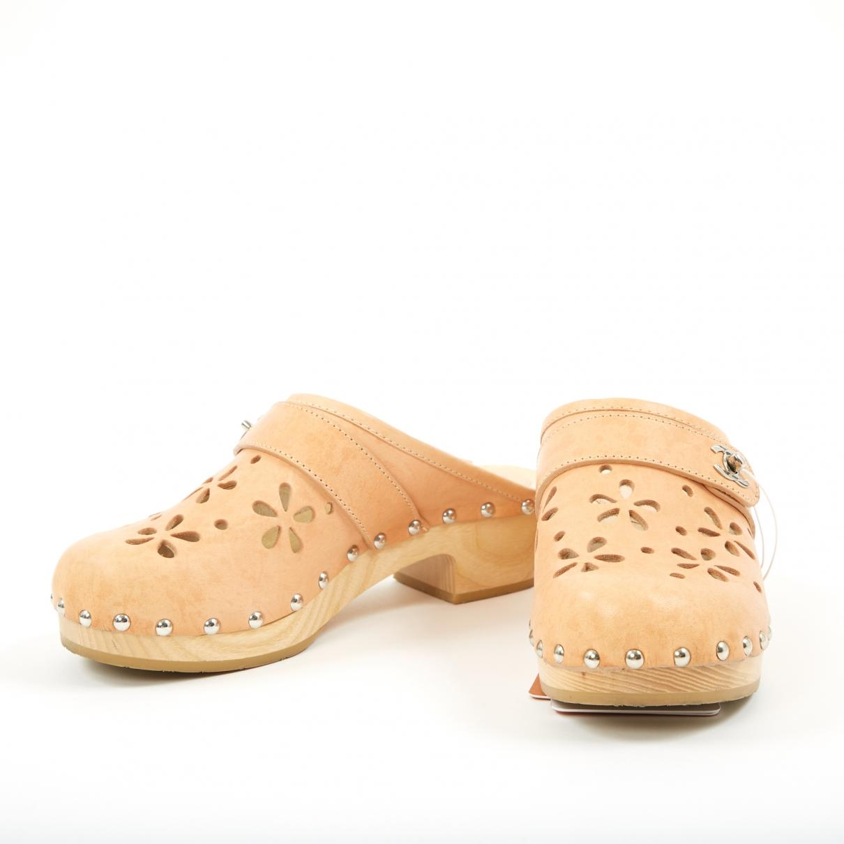 4c87fd9e9bb Chanel Beige Leather Mules   Clogs in Natural - Lyst