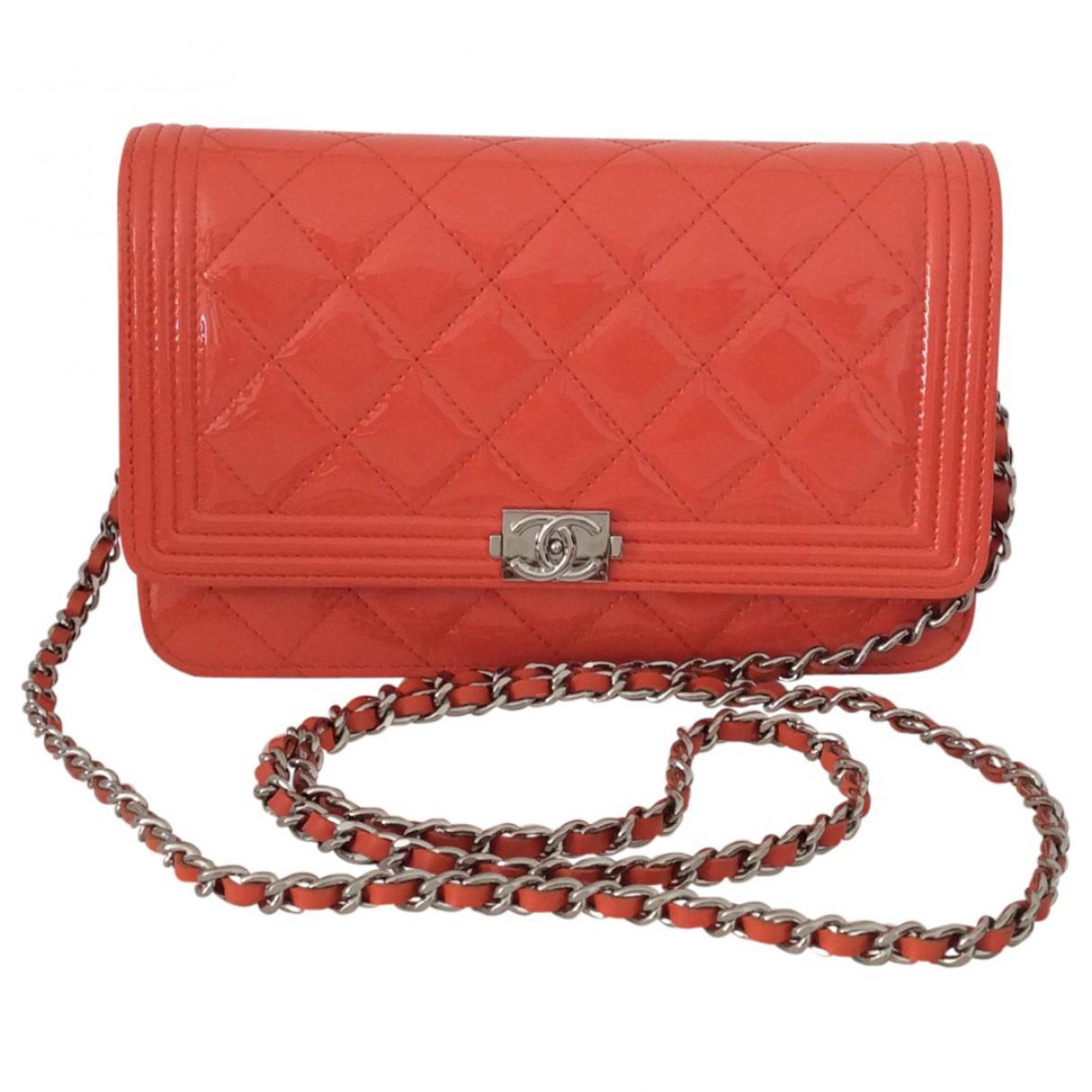 e969b9fe8b25 Lyst - Chanel Orange Patent Leather Handbag Boy in Orange